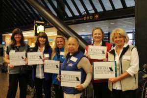 Travel agents at airport with signs