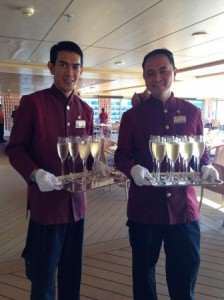 cruise crew with champagne glasses