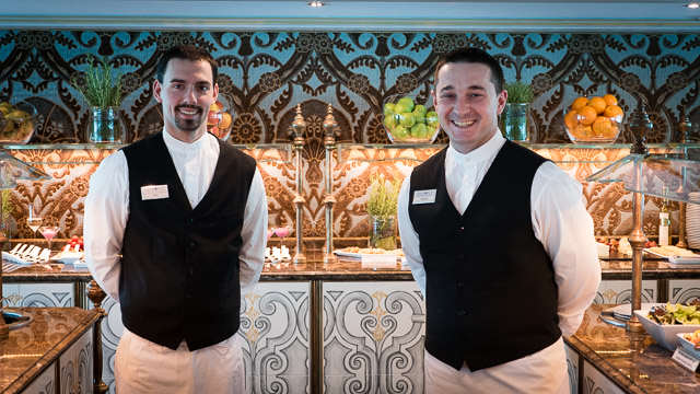 Friendly waiters on Uniworld's S.S. Maria Theresa. © 2015 Ralph Grizzle