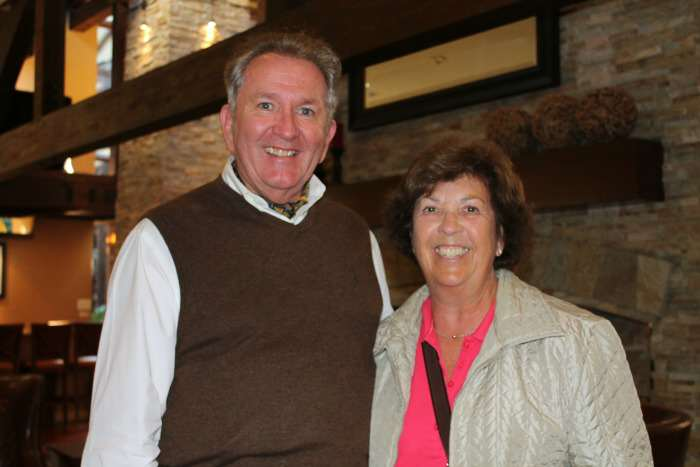 Cruise Specialists host Tom Mullens paused a conversation with a guest for a photo.