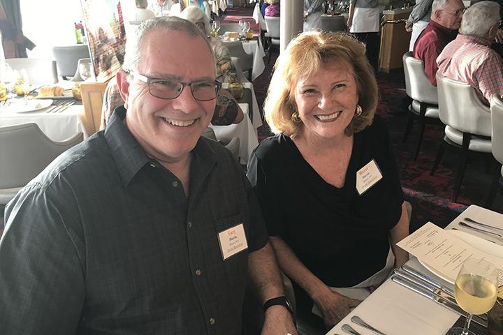 Couple dining aboard world cruise