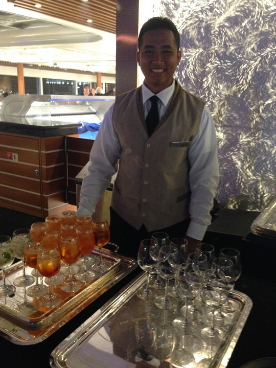 cruise ship staff with champagne