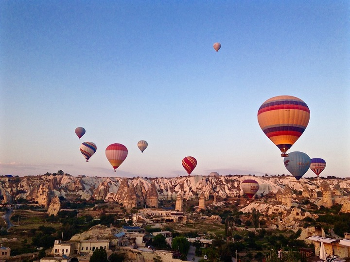 Hot air balloons over rock formations