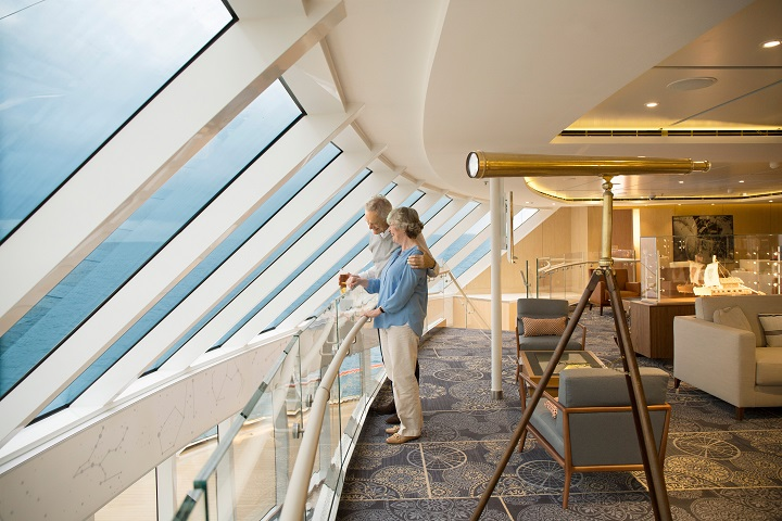 couple looking out window on cruise ship